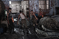 Daily wage labourers working in a tannery in Jajmau area, Kanpur, Uttarpradesh, India. They earn 60.00 USD TO 150.00 USD per month depending on experience to kind of job they have to do. Working in a tannery is a hazardous job. Exposure to the harmful chemicals used in the tannery causes skin diseases, respiratory diseases, gastro-intestinal ailments etc. Researches have shown presence of elevated amount of chromium in the blood and urine of the workers. Kanpur, Uttar Pradesh, India. Arindam Mukherjee