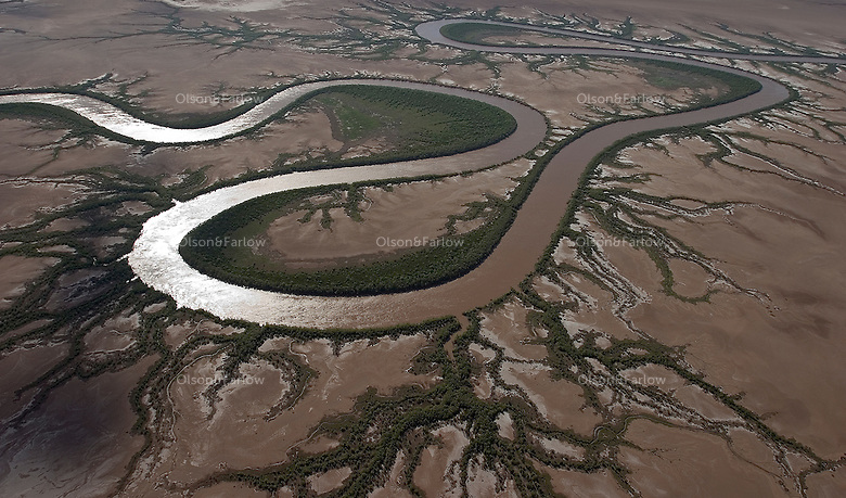 Aerial of tidal mud flats just outside town of Wyndham. Mudflats are drivable during the dry season.  This is mpossible to do during the wet. The rains wash the dirt into the rivers and creeks and the silt runs out to the ocean.