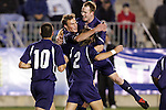 11 November 2005: Duke University's Blake Camp (behind #2 Tim Jepson) accepts the congratulations of teammates following his first goal of the game, a free kick in the 13th minute which gave Duke a 1-0 lead. Duke University defeated the University of Maryland 4-2 at SAS Stadium in Cary, North Carolina in a semifinal of the 2005 ACC Men's Soccer Championship.