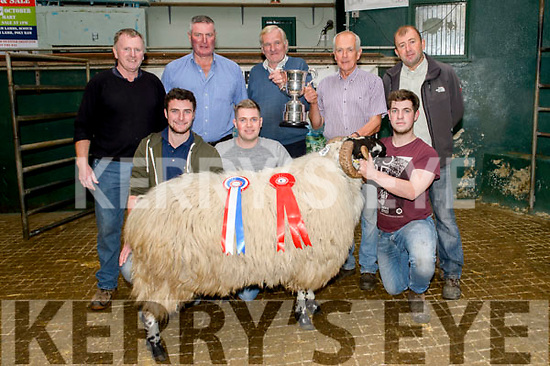 Mike Farrell with his prize Ram and Overall Champion at the Kerry Blackface Sheep Breeders Association Mart in Milltown on Saturday, pictured front l-r; Jonathan Egan(Judge), James Farrell, Eoin Farrell, back l-r; Mike O'Brien (Secretary), John Egan (Judge), Dan McCarthy(Chairman), Mike Farrell(Owner) & Martin Ashe(Treasurer).