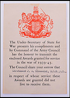 BNPS.co.uk (01202 558833)Pic: C&amp;TAuctions/BNPS<br /> <br /> A document enclosed award granted for the service in the war of 1939 - 1945 for Lieutenant James Riccomini MBE. <br /> <br /> The remarkable story of an SAS hero who escaped captivity by jumping out of a moving train and carried out daring raids behind enemy lines before he was killed storming a German stronghold can be told after his bravery medals emerged for sale.<br /> <br /> After escaping his German captors, Lieutenant James Riccomini MBE spent four months assisting Italian resistance fighters with ammunition drops and intelligence gathering before scaling the Alps to reach neutral Switzerland when his cover was blown.<br /> <br /> Ten months later, he was dropped behind enemy lines and led a fearless ambush of a German armoured column before he was killed in action heading up an assault during the legendary Operation Tombola.<br /> <br /> His MBE, Military Cross and other medals along with letters he wrote to his wife, documents and photos are tipped to sell for &pound;12,000.