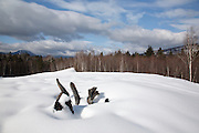 Mountain range from a sandpit along the Kancamagus Highway during the winter months in the White Mountains, New Hampshire USA. This area was part of the Swift River Railroad, which was an logging railroad in operation from 1906-1916.