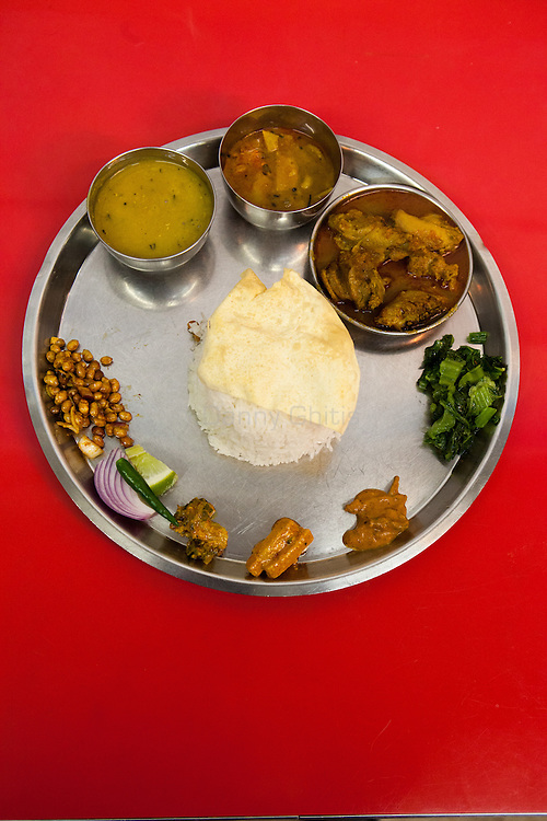 Dhaulagiri Kitchen, a tiny Nepalese restaurant in Jackson Heights. Pictured, chicken thali.<br /> <br /> Danny Ghitis for The New York Times