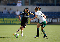FC Gold Pride forward Marta (10) makes a move against Red Stars defender Lydia Vanderbergh (21).  The FC Gold Pride defeated the Chicago Red Stars 3-2 at Toyota Park in Bridgeview, IL on August 22, 2010