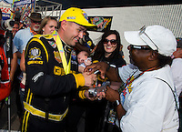 Sept. 1, 2014; Clermont, IN, USA; A fan gets an autograph from NHRA top fuel dragster driver Richie Crampton as he celebrates after winning the US Nationals at Lucas Oil Raceway. Mandatory Credit: Mark J. Rebilas-USA TODAY Sports