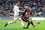 Dani Carvajal of Real Madrid and Alex Moreno of Rayo Vallecano during La Liga match between Real Madrid and Rayo Vallecano at Santiago Bernabeu Stadium in Madrid, Spain. December 15, 2018. (ALTERPHOTOS/Borja B.Hojas)