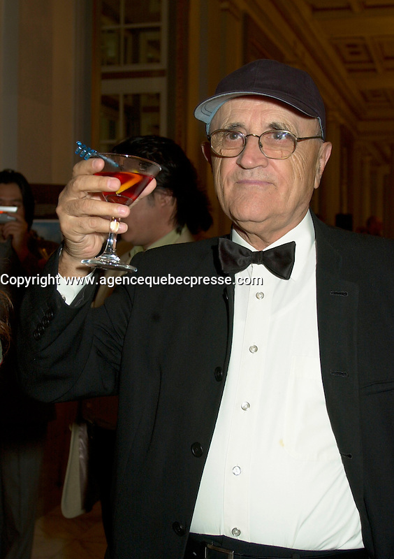 Sept 2nd  2002, Montreal, Quebec, Canada<br /> <br /> Serge Losique, President and founder of the  Montr&Egrave;al World Film Festival hold a martini during the closing reception at the Windsor, september 2nd 2002 in Montreal, Canada<br /> <br /> The 2003 Montreal World Film  Festival will be held at the same date as the Toronto Festival of Festival.<br /> <br /> <br /> Mandatory Credit: Photo by Pierre Roussel- Images Distribution. (&copy;) Copyright 2002 by Pierre Roussel <br /> <br /> NOTE : <br />  Nikon D-1 jpeg opened with Qimage icc profile, saved in Adobe 1998 RGB<br /> .Uncompressed  Original  size  file availble on request.