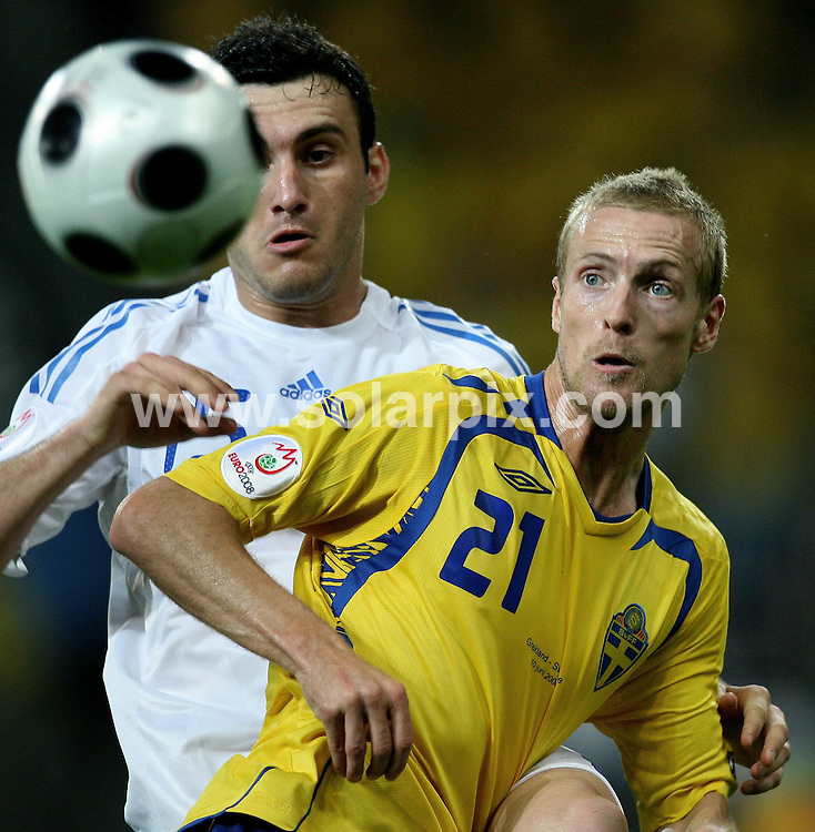 **ALL ROUND PICTURES FROM SOLARPIX.COM**.**SYNDICATION RIGHTS FOR UK AND SPAIN ONLY**.European Championship tournament Euro 2008, Greece versus Sweden at the Wals-Siezenheim Stadium, Salzburg, Austria. Sweden 2 Greece 0. 10th June 2008..This pic: Vassilis Torosidis and Christian Wilhelmsson..JOB REF: 6606 CPR/Ronny Hartmann       .DATE: 10_06_2008.**MUST CREDIT SOLARPIX.COM OR DOUBLE FEE WILL BE CHARGED* *UNDER NO CIRCUMSTANCES IS THIS IMAGE TO BE REPRODUCED FOR ANY ONLINE EDITION WITHOUT PRIOR PERMISSION*