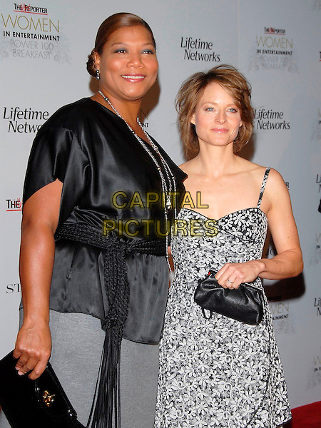 QUEEN LATIFAH & JODIE FOSTER.Attends The 16th Annual Women in Entertainment Breakfast held at The Beverly Hills Hotel in Beverly Hills, California, USA, December 04 2007.                                                                  half length black and white floral print dress top.CAP/DVS.©Debbie VanStory/Capital Pictures