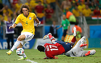 FORTALEZA - BRASIL -04-07-2014. Foto: Roberto Candia /Archivolatino<br /> Carlos Bacca (#10) jugador de Colombia (COL) recibe falta para penal de Julio Cesar (#12) arquero de  Brasil (BRA) mientras David Luiz (#4) coge el balón durante partido de los cuartos de final por la Copa Mundial de la FIFA Brasil 2014 jugado en el estadio Castelao de Fortaleza./ Carlos Bacca (#17) player of Colombia (COL) receives a penalty from Julio Cesar (#12)  Brazil (BRA) while David Luiz (#4) gets the ball during the match of the Quarter Finals for the 2014 FIFA World Cup Brazil played at Castelao stadium in Fortaleza. Photo: Roberto Candia /Archivolatino<br /> VizzorImage PROVIDES THE ACCESS TO THIS PHOTOGRAPH ONLY AS A PRESS AND EDITORIAL SERVICE IN COLOMBIA AND NOT IS THE OWNER OF COPYRIGHT; ANOTHER USE IS REPONSABILITY OF THE END USER. NO SALES, NO MERCHANDASING. ALL COPYRIGHT IS ARCHIVOLATINO
