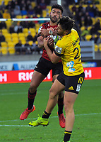 Crusaders' Richie Mo'unga and Hurricanes' Kobus Van Wyk compete for the ball during the Super Rugby Aotearoa match between the Hurricanes and Crusaders at Sky Stadium in Wellington, New Zealand on Saturday, 21 June 2020. Photo: Dave Lintott / lintottphoto.co.nz