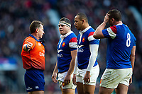 Referee Nigel Owens speaks with France players during a break in play. Guinness Six Nations match between England and France on February 10, 2019 at Twickenham Stadium in London, England. Photo by: Patrick Khachfe / Onside Images