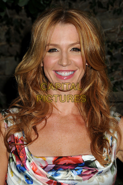 POPPY MONTGOMERY .3rd Annual Women In Film Pre-Oscar Party held at a Private Residence in Beverly Hills, California, USA, .4th March 2010..portrait headshot smiling sleeveless  floral red white blue print flower ruched silk satin  .CAP/ADM/BP.©Byron Purvis/AdMedia/Capital Pictures.