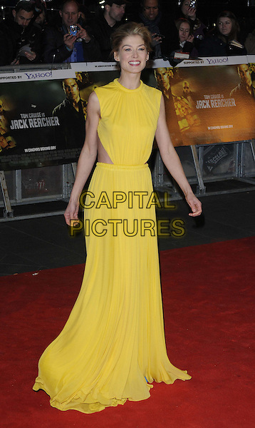 """Rosamund Pike.The World Premiere of """"Jack Reacher"""", Odeon Leicester Square, London..10th December 2012.full length sleeveless dress cut out away yellow  .CAP/CAN.©Can Nguyen/Capital Pictures."""