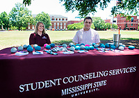 Rachel-Clair Franklin and Chris Austin, both staff counselors in MSU Student Counseling Services, host a &quot;Mindfulness Monday&quot; table on the Drill Field. The event, sponsored by Student Counsing Services and the Holmes Cultural Diversity Center, encourages participants to pay attention in the present moment without judgment or evaluation, which can improve focus and help manage stress. The next Mindfulness Monday will take place on July 16 from 12-1 p.m. on the Drill Field.<br />