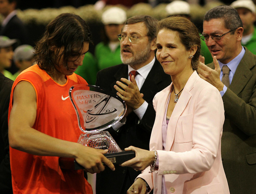 Photo: Sportsbeat.Madrid, ATP Masters Series 2005..23/10/2005..Rafael Nadal (L) collects his trophy after winning the ATP Masters Series in Madrid.
