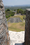 The main plaza seen from El Castillo at the Mayan ruins of Xunantunich. Mayan for The Stone Maiden, or Lady of the Rocks, the Mayan city was named after an apparition of a woman who has appeared at the site, located in the Cayo District of Belize. Most of the structures date from the Maya Classic Era, about 200 to 900.