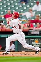 Matt Vinson #20 of the Arkansas Razorbacks follows through on his swing against the Texas Tech Red Raiders at Minute Maid Park on March 2, 2012 in Houston, Texas.  The Razorbacks defeated the Red Raiders 3-1. (Brian Westerholt/Four Seam Images)