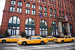 Yellow cabs before the Puck Building on Lafayette street, NYC, USA. Design by Albert and Herman Wagner.
