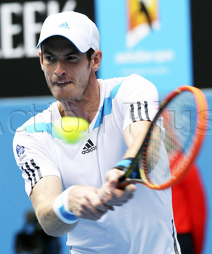 18.01.2014. Melbourne, Australia. Australian Open 2014, Melbourne Park,ITF Grand Slam Tennis Tournament. Andy Murray of Great Britain returns the ball during the men s singles third round match against Feliciano Lopez of Spain at the Australian Open tennis tournament in Melbourne, Australia, Jan. 18, 2014. Murray won 3-0.