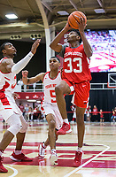 NWA Democrat-Gazette/BEN GOFF @NWABENGOFF<br /> Jimmy Whitt (33), Arkansas guard, shoots as Reggie Chaney, Arkansas forward, and Jalen Harris (5), Arkansas quard, defend in the first half Saturday, Oct. 5, 2019, during the annual Arkansas Red-White Game at Barnhill Arena in Fayetteville.