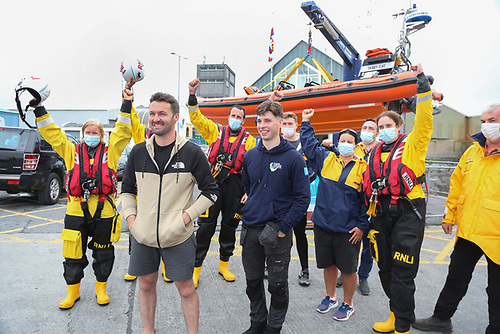 Patrick Oliver and his son Morgan, who rescued cousins Ellen Glynn and Sara Feeney off Inis Oirr island, with some of Patrick's RNLI colleagues on their arrival back at the Galway RNLI Lifeboat Station at Galway Docks