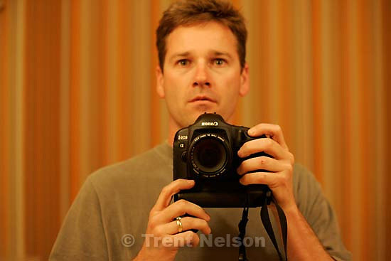 Trent Nelson in mirror with new Canon 1D Mark 2; 4/30/04<br />