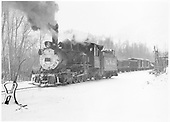 3/4 fireman's-side view of D&amp;RGW #318 switching cars on the last run at Ouray.<br /> D&amp;RGW  Ouray, CO  Taken by Richardson, Robert W. - 3/21/1953