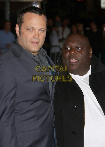 "VINCE VAUGHN & FAIZON LOVE.""Couples Retreat"" Los Angeles Premiere held at Mann Village Theatre, Westwood, CA, USA..October 5th, 2009.half length black white jacket shirt top mouth open grey gray blue green.CAP/ADM/CH.©Charles Harris/AdMedia/Capital Pictures"