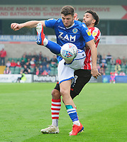 Macclesfield Town's James Pearson under pressure from Lincoln City's Bruno Andrade<br /> <br /> Photographer Chris Vaughan/CameraSport<br /> <br /> The EFL Sky Bet League Two - Lincoln City v Macclesfield Town - Saturday 30th March 2019 - Sincil Bank - Lincoln<br /> <br /> World Copyright © 2019 CameraSport. All rights reserved. 43 Linden Ave. Countesthorpe. Leicester. England. LE8 5PG - Tel: +44 (0) 116 277 4147 - admin@camerasport.com - www.camerasport.com