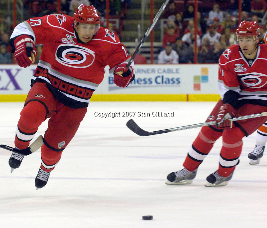 The Carolina Hurricanes' Ray Whitney jumps the stick of the Philadelphia Flyers' Rory Fitzpatrick (left) as he races for a puck Wednesday, Nov. 21, 2007 in Raleigh, NC. The Flyers won 6-3.