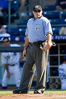 Home plate umpire Craig Barron during the International League game between the Charlotte Knights and the Durham Bulls at Durham Bulls Athletic Park on August 28, 2011 in Durham, North Carolina.   (Brian Westerholt / Four Seam Images)
