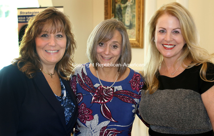 SOUTHINGTON CT. 21 October 2016-102116SV12-From left, Laurie Genovese of Waterbury, Palace Theatre, Patricia Chavat of Waterbury, Waterbury Hospital, and Heather Musante Mitchell of Watertown attend the Woman&rsquo;s Business Forum in Southington Friday. The 34th annual scholarship fundraising event was sponsored by the Greater Waterbury Chamber of Commerce Foundation.<br /> Steven Valenti Republican-American