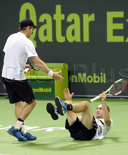 03.01.2014. Doha, Qatar.  Alexander Peya (L) of Austria helps Bruno Soares of Brazil during the men s doules final against Tomas Berdych and Jan Hajek of Czech Republic in Qatar Open tennis tournament, Jan. 3, 2014. Alexander Peya and Bruno Soares lost the match 0-2.