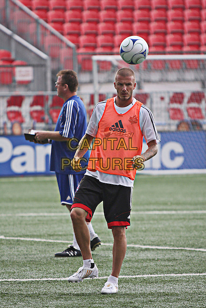 DAVID BECKHAM.L.A. Galaxy superstar David Beckham makes his Toronto playing debut at the MLS All Star Game between the MLS All Stars and West Ham United at BMO Field, Toronto, Ontario, Canada, 24 July 2008..football footballer sport game training player playing full length ball  shorts adidas kit .CAP/ADM/BPC.©Brent Perniac/Admedia/Capital Pictures