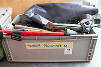 """Das Berliner Start-up """"mimycri"""" produziert Taschen aus den Gummiplanen gestrandeter Fluechtlingsboote.<br /> Statt Griechenlands Straende im Muell der gestrandeten Fluechtlingsboote ersticken zu lassen, stellt das Berliner Unternehmen """"mimycri"""" daraus Taschen und Rucksaecke her und bietet Fluechtlingen eine Chance auf Normalitaet und Regelmaessigkeit.<br /> Im Bild: Eine Kiste mit Mustern von Taschen und Ruchsaecken.<br /> 8.8.2017, Berlin<br /> Copyright: Christian-Ditsch.de<br /> [Inhaltsveraendernde Manipulation des Fotos nur nach ausdruecklicher Genehmigung des Fotografen. Vereinbarungen ueber Abtretung von Persoenlichkeitsrechten/Model Release der abgebildeten Person/Personen liegen nicht vor. NO MODEL RELEASE! Nur fuer Redaktionelle Zwecke. Don't publish without copyright Christian-Ditsch.de, Veroeffentlichung nur mit Fotografennennung, sowie gegen Honorar, MwSt. und Beleg. Konto: I N G - D i B a, IBAN DE58500105175400192269, BIC INGDDEFFXXX, Kontakt: post@christian-ditsch.de<br /> Bei der Bearbeitung der Dateiinformationen darf die Urheberkennzeichnung in den EXIF- und  IPTC-Daten nicht entfernt werden, diese sind in digitalen Medien nach §95c UrhG rechtlich geschuetzt. Der Urhebervermerk wird gemaess §13 UrhG verlangt.]"""