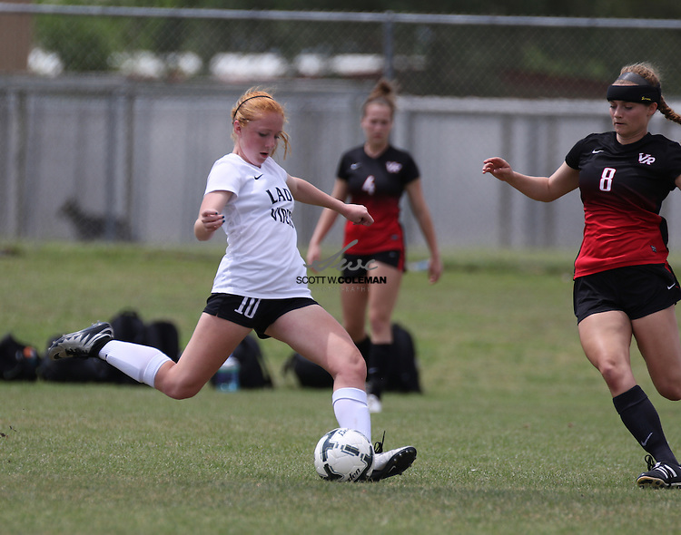 Vandegrift junior midfielder Grace Erdman (10) passes the ball during the soccer regional final playoff game between Vandegrift High School and Vista Ridge High School on April 9, 2016. Vista Ridge defeated Vandegrift 2-1 to advance to the state tournament.