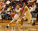 SIOUX FALLS, SD - NOVEMBER 25: Trevon Evans #4 from the University of Sioux Falls drives against KJ Davis #14 from Southwest Minnesota State University during their game Saturday night at the Stewart Center in Sioux Falls. (Photo by Dave Eggen/Inertia)