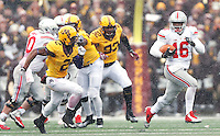 Ohio State Buckeyes quarterback J.T. Barrett (16) runs for a big gain in the second quarter of the college football game between the Ohio State Buckeyes and the Minnesota Golden Gophers at TCF Bank Stadium in Minneapolis, Saturday morning, November 15, 2014. As of half time the Ohio State Buckeyes led the Minnesota Golden Gophers 17 - 14. (The Columbus Dispatch / Eamon Queeney)