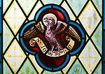Eagle symbol of Saint John the Evangelist nineteenth century stained glass window at Holy Trinity church, Easton Royal, Wiltshire, England, UK unknown artist