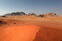 Mountains of sandstone and granite emerging from wide sandy valleys to reach heights of 1700 meters and more, Wadi Rum Protected Area (WRPA), Wadi Rum National Park, also known as The Valley of the Moon, 74,000-hectare, UNESCO World Heritage Site, desert landscape, southern Jordan, Middle East. Picture by Manuel Cohen