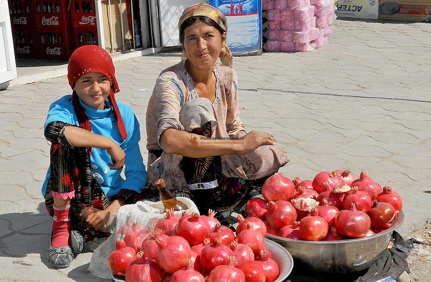 Portrait of pomegranate vendors