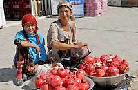 Portrait of pomegranate vendors