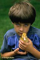 DG12-017x  Pekin Duck - ten day old duckling with boy
