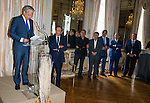 "Michel Drucker and Deputy Prime Minister Didier Reynders with (LtoR)François Pirette, Salvatore Adamo, Eddy Merckx, Jacky Ickx, Eric-Emmanuel Schmitt at the ceremony who Michel Drucker was awarded at  the title of Commander of the Order of the Crowne at the Palace Egmont"" at Brussels, 2014 in Brussels, Belgium."