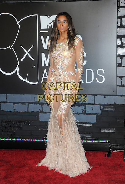 Ciara (Ciara Princess Harris)<br /> 2013 MTV Video Music Awards held at The Barclays Center, Brooklyn, New York, USA.<br /> August 25th, 2013<br /> full length white silver sheer feather sheer embellished jewel encrusted see through thru dress  VMA VMAS<br /> CAP/ADM/MPI/C99<br /> &copy;C99/MPI/AdMedia/Capital Pictures