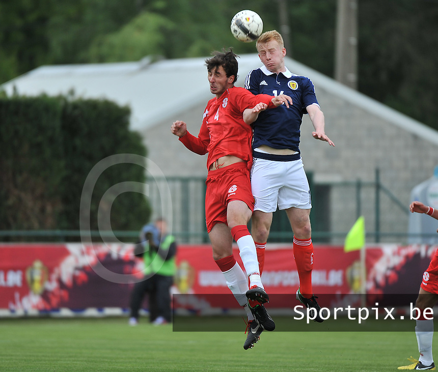 Scotland U19 - Georgia U19 : Heading duel between Mark Beck (16) and Nika Sandokhadze (4).foto DAVID CATRY / Nikonpro.be