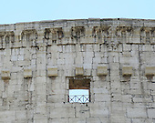 Exterior photo of the top architecture of the remaining outer wall of the Colosseum, also known as the Flavian Amphitheatre, showing some of the two hundred and forty brackets or corbels, that held tall beams of wood that supported the awning or velarium, in Rome, Italy on Friday, May 25, 2012.  Also clearly visible are the individual blocks making up the structure and the alternating windows and pilasters..Credit: Ron Sachs / CNP