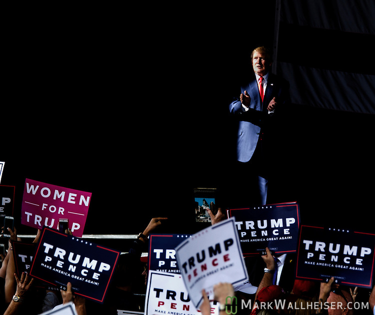 ST. AUGUSTINE, FL - OCTOBER 24:   Republican presidential candidate Donald Trump applauds in a shaft of sunlight as he leaves a rally at the St. Augustine Amphitheater on October 24, 2016 in St. Augustine, Florida.  With just over two weeks to go until the election, early voting has started in Florida. (Photo by Mark Wallheiser/Getty Images)