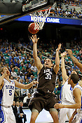Justin Maneri rebounds the ball in the first half. Lehigh defeated Duke 75-70 during the 2nd round of the 2012 NCAA Basketball Championship at the Greensboro Coliseum in Greensboro, NC. Photo by Al Drago.